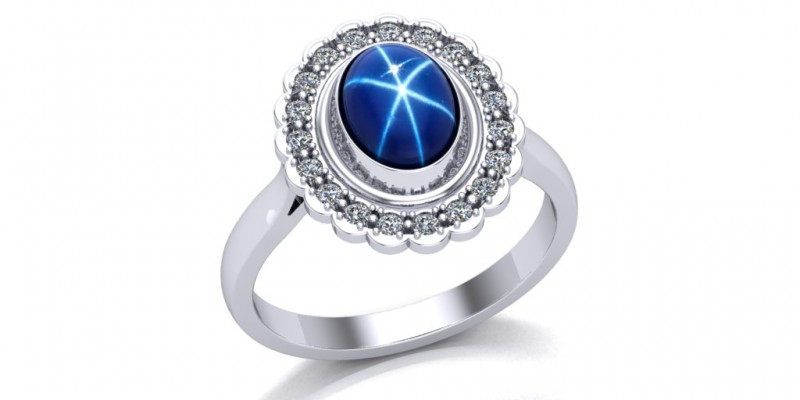 18ct White Gold Blue Star Cabochon Sapphire and Diamond Ring